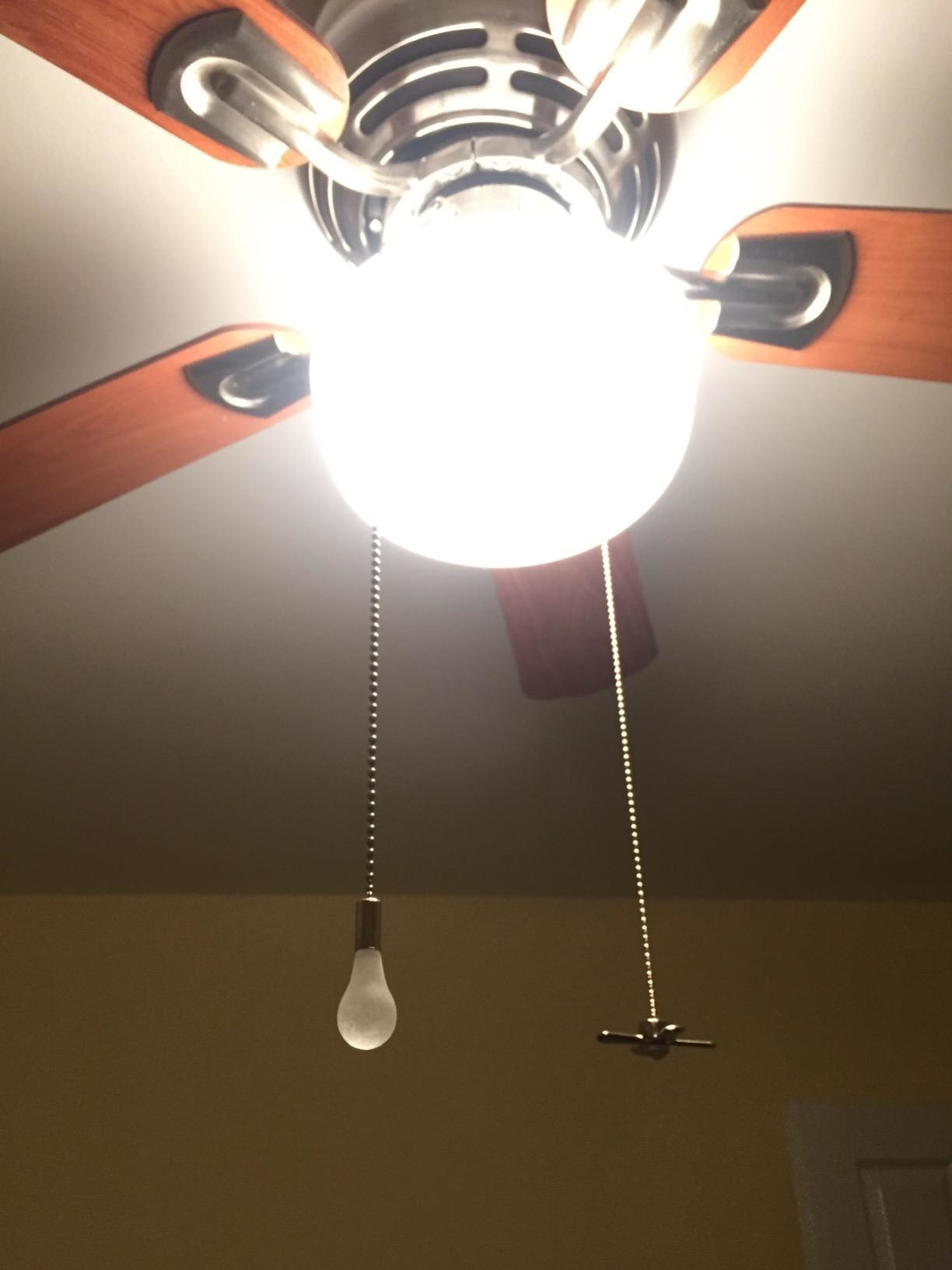 two chains with charms shaped like a lightbulb and fan