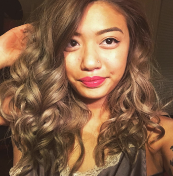a reviewer with bouncy curls