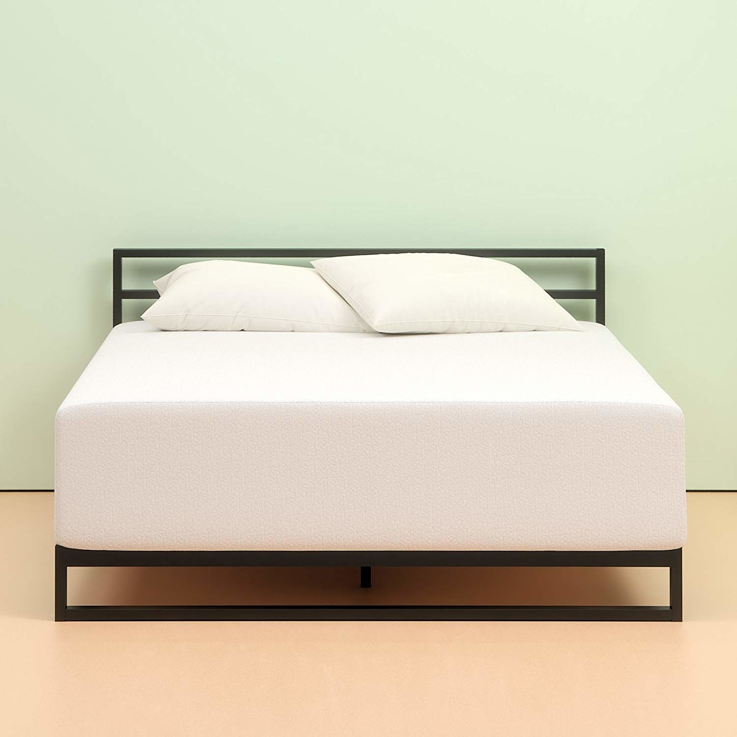 thick white mattress on a bed frame