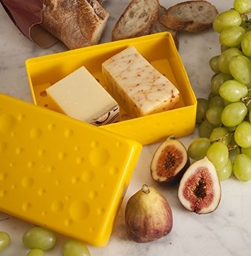 A yellow rectangular box that looks like cheese with two blocks of cheese in it