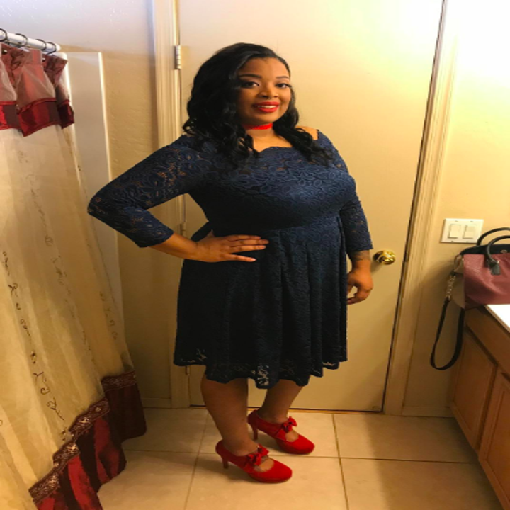 A reviewer wearing the dress in navy