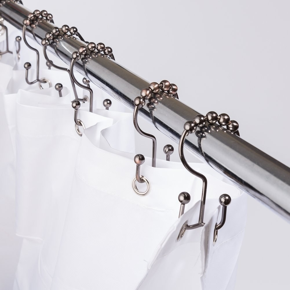 The shower curtain rings with attached balls for easy gliding