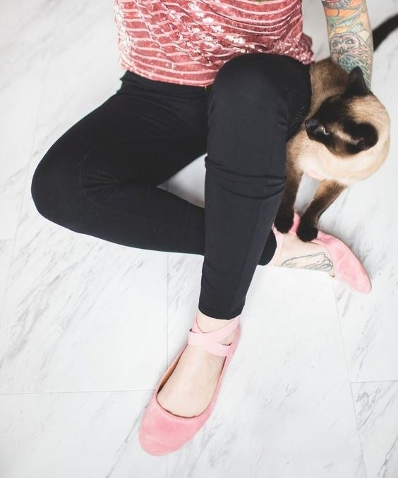 Reviewer lounges wearing the flats