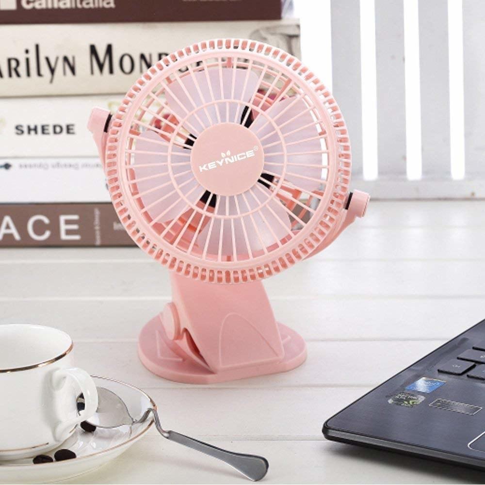 a pink small desk fan