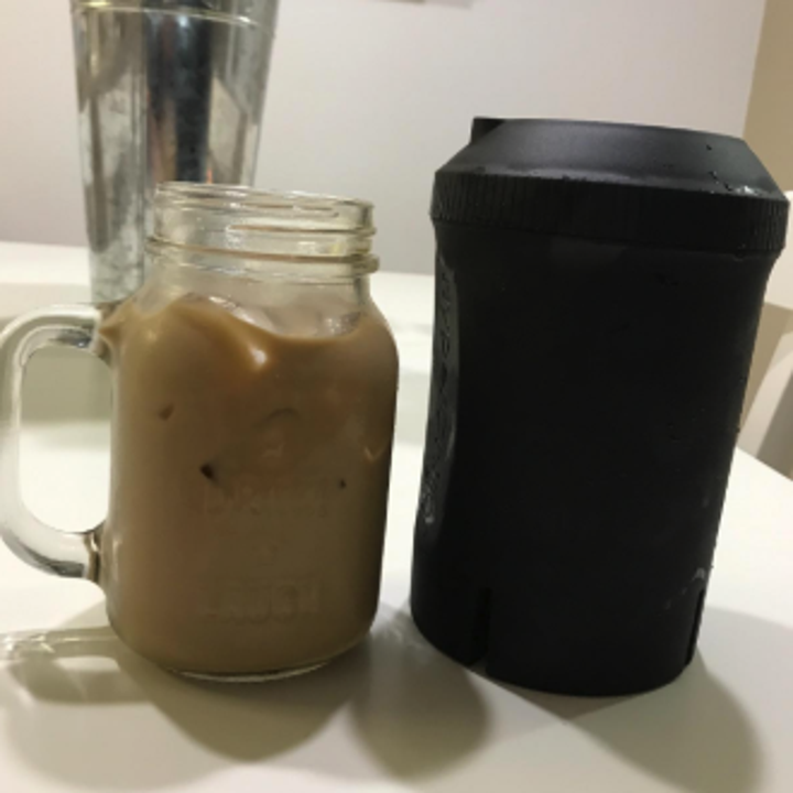 a reviewer photo of ice coffee next to the chiller