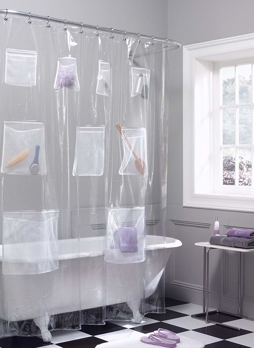 The shower curtain with a variety of shower items inside its many pockets