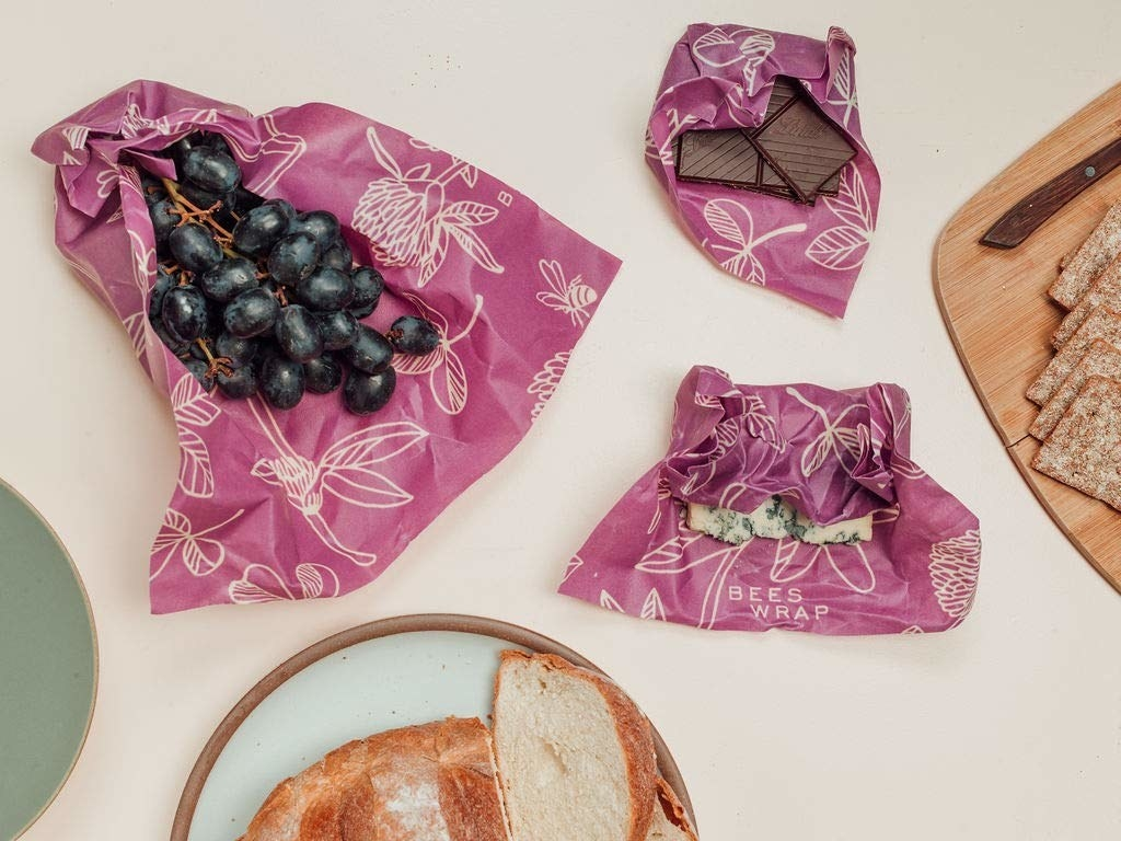 The Beeswax paper covering cheese, grapes, and chocolate