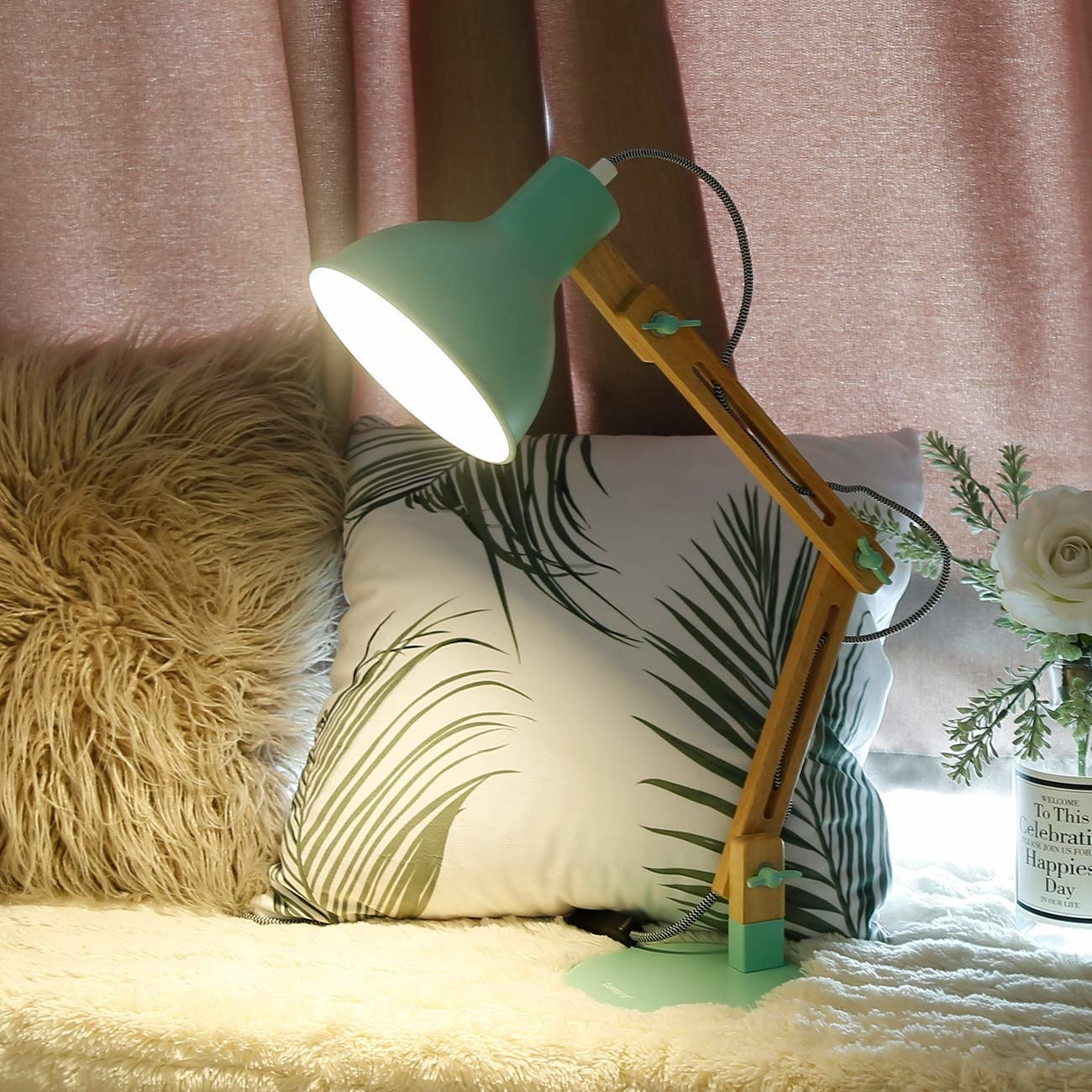 the mint green lamp in front of two pillows