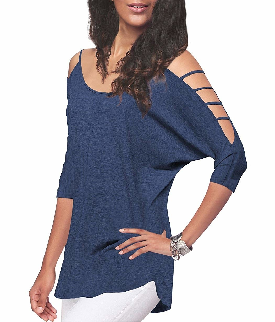A model wearing the cutout sleeve top in blue.
