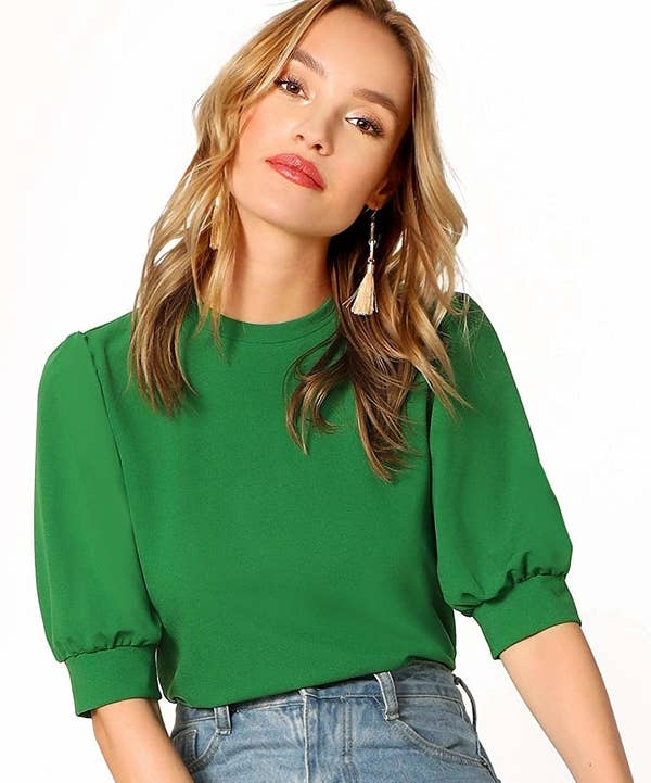 A model wearing the balloon sleeve blouse in green.