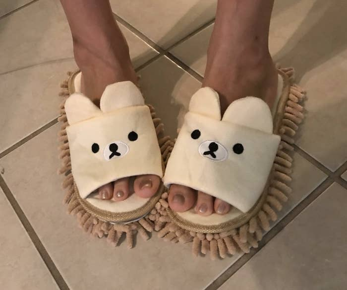 Reviewer wearing the mop slippers