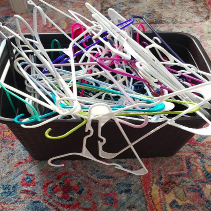 Unorganized hangers tossed in bin