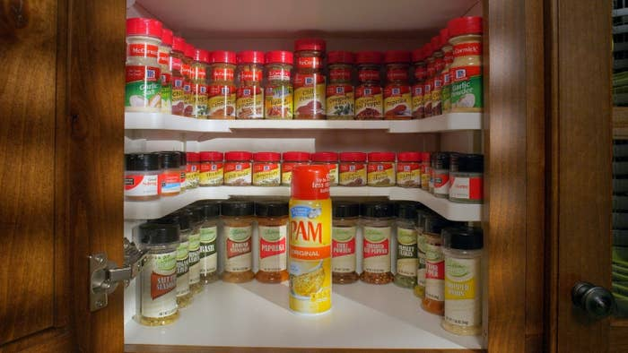 three racks of spices lined up on the Spicy Shelf in a cabinet