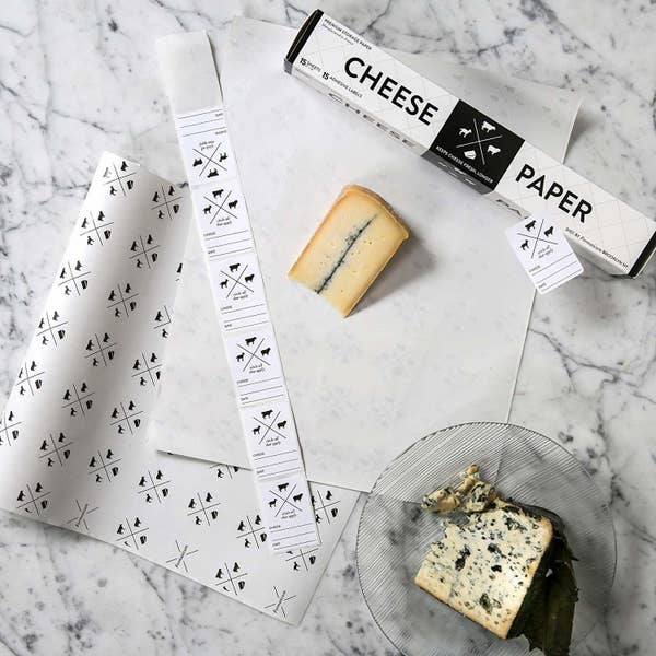 The paper with wedges of cheese