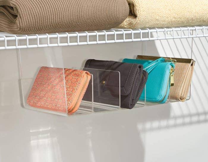 Clear hanging organizer tray holding handbags