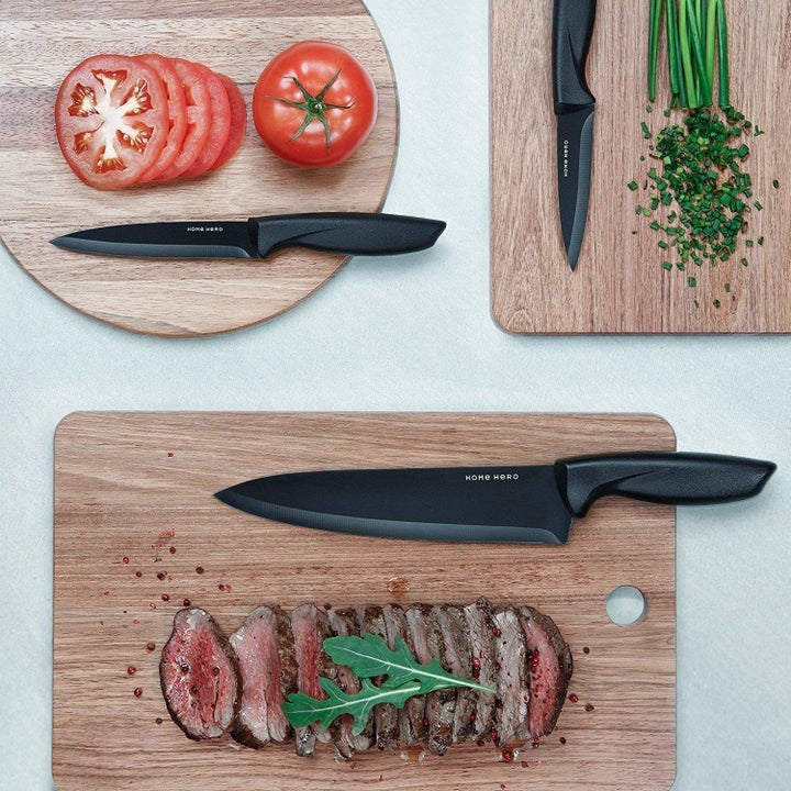 The chef's knife and two paring knives on cutting boards