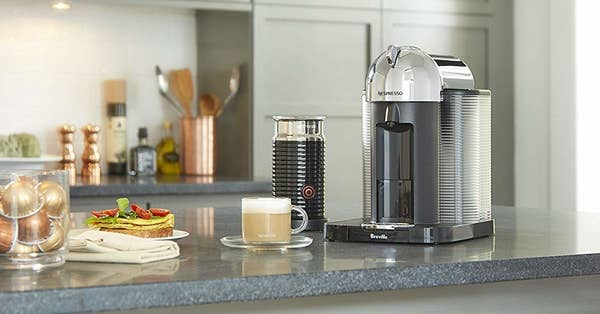 The espresso machine and milk frother on a counter