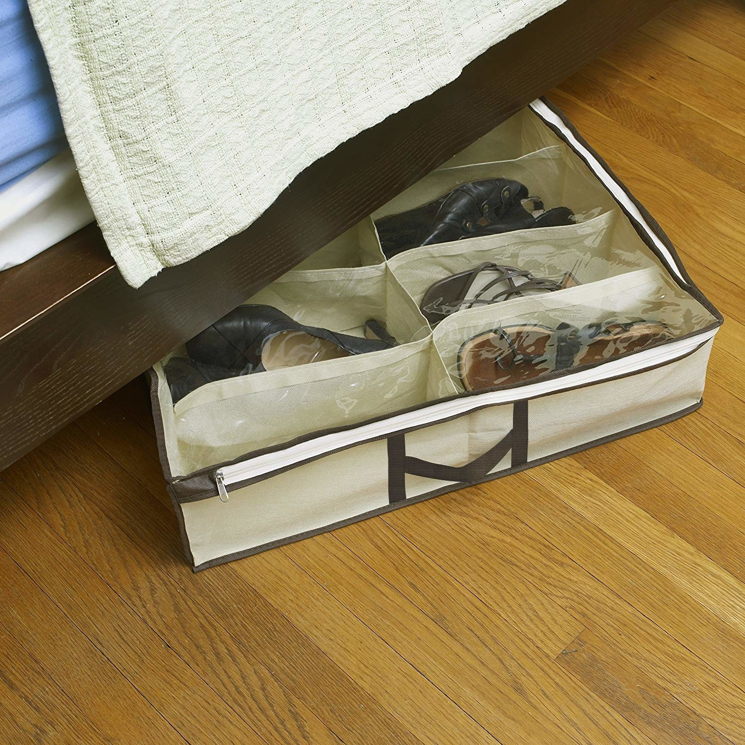 a bed with a shoe organizer peaking out from underneath with a clear lid