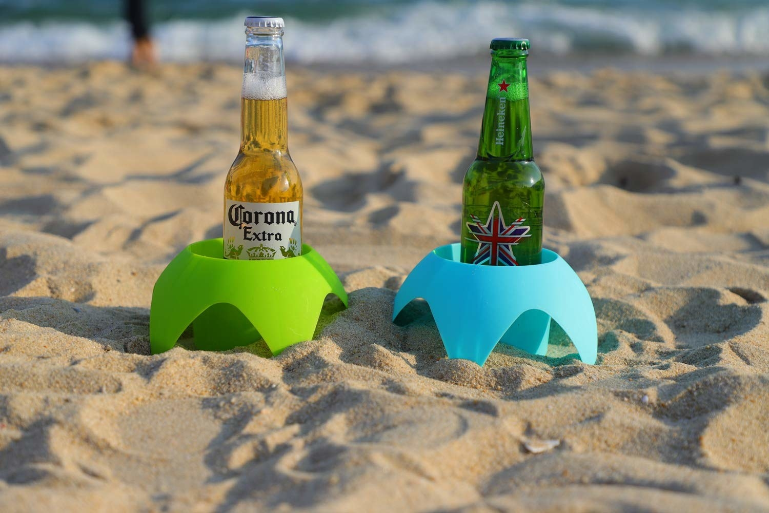 two beers in holds with spikes that dig into sand