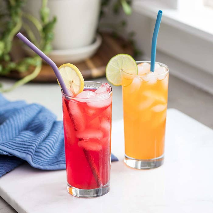 the straws being used with two drinks in glass cups