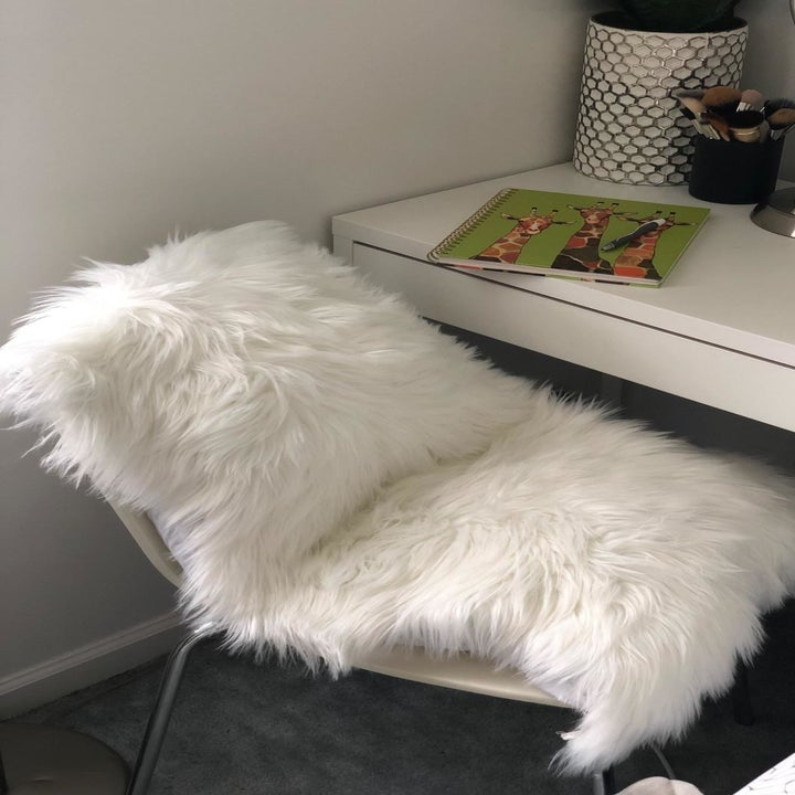 the white rug on a chair