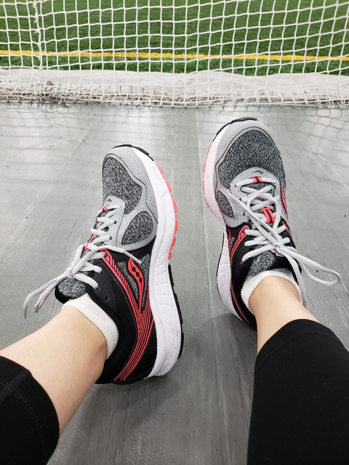 Reviewer wearing Saucony Cohesion 10s