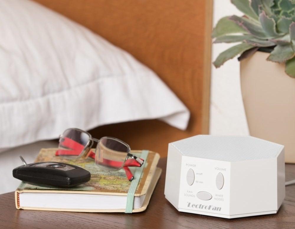 White geometric sound box on side table
