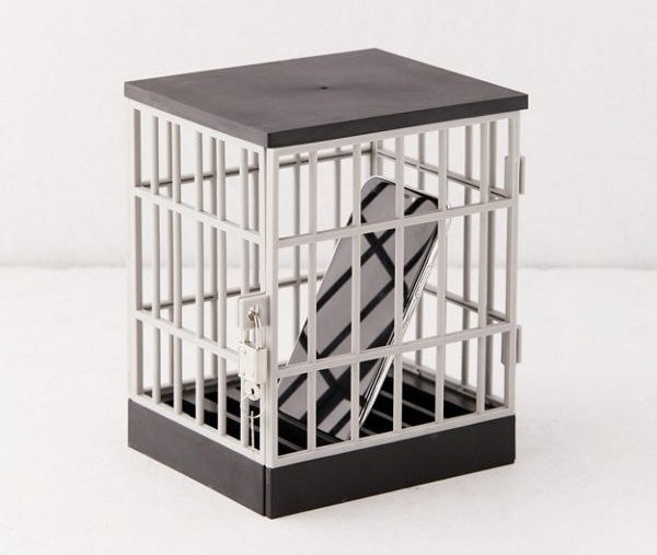 a phone inside a small cage