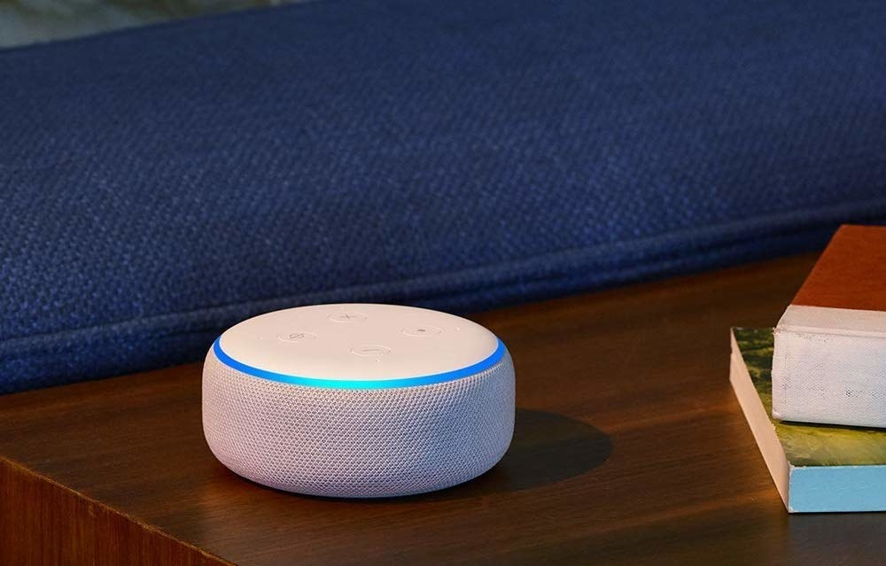 a white echo dot on a side table