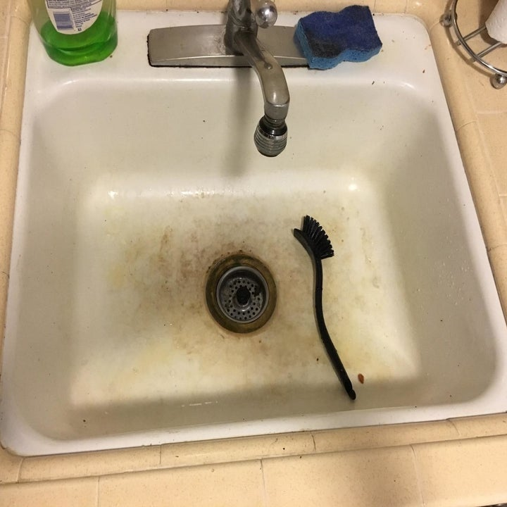reviewer's white sink before, with a visible layer of brown scum