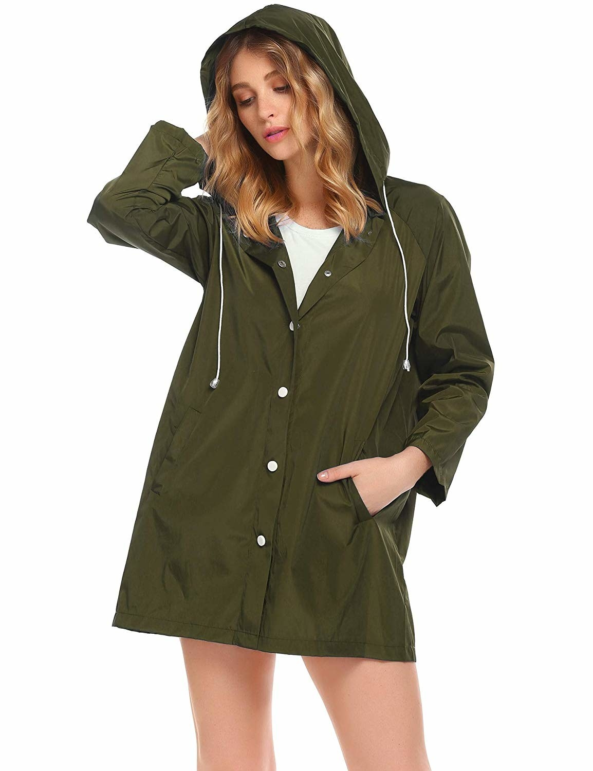 A model wearing the raincoat in army green