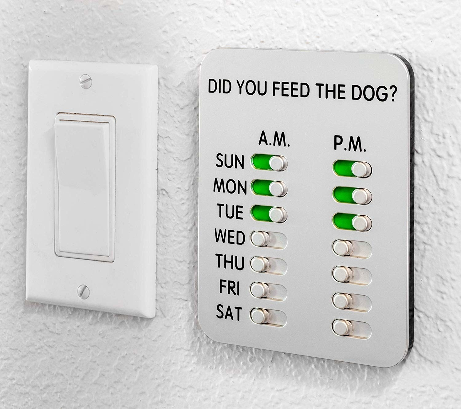 "the magnetic slider that says ""did you feed the dog?"" at the top and lists each day of the week with the option to check off AM or PM on it"