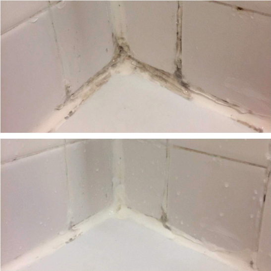 A reviewer's before: the corner of a shower, with mold in both the caulk and grout and after: the same corner, with all but a few specks of the mold gone