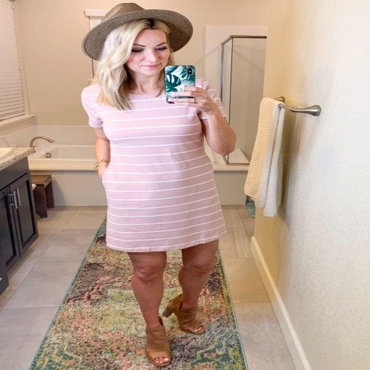 Reviewer wearing pink dress