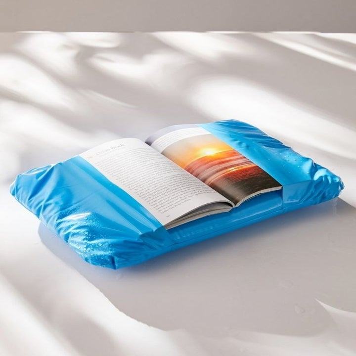 a book inside the blue inflatable book jacket