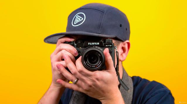 model holds camera