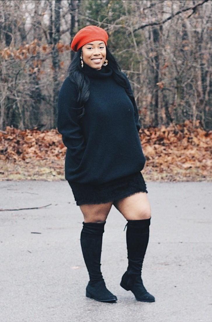 Reviewer wearing black dress