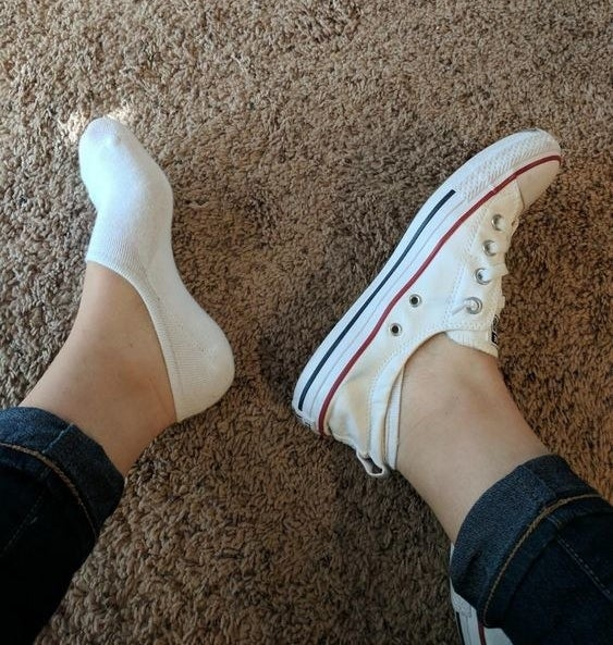 Reviewer wearing the no-show socks with Converses to show how they're barely visible