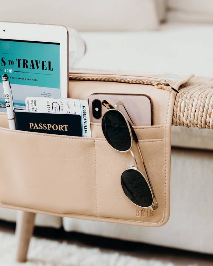 beige pocket with spaces for different spots for phone, iPad, passport, sunglasses, and more