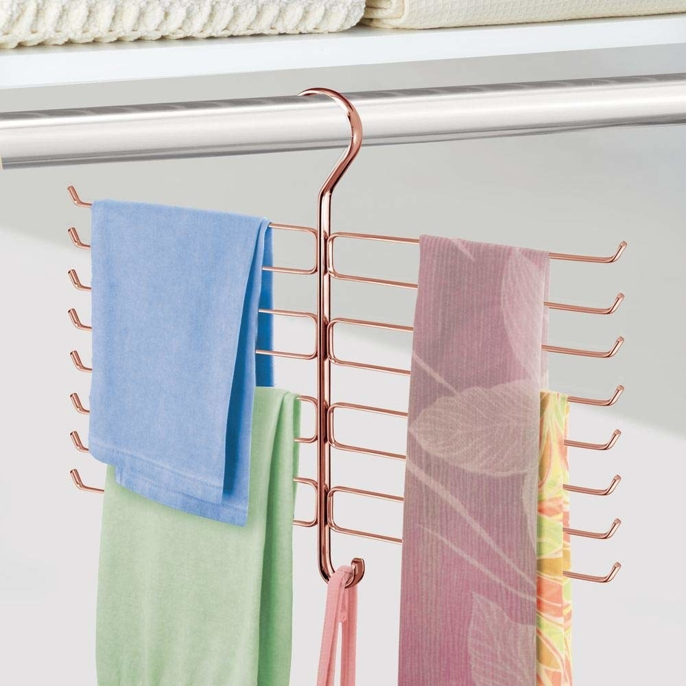 the scarf hanging in a closet