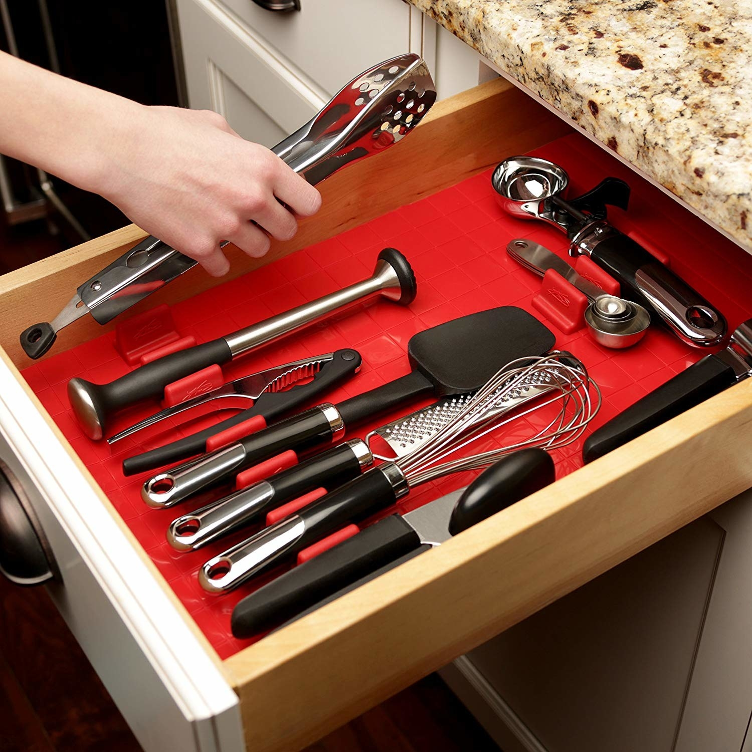 open kitchen drawer with red silicone organizer in it with movable organizer parts to change up design with your needs