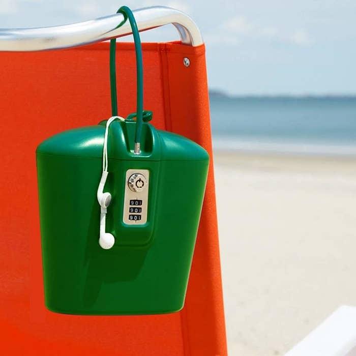 the green lockbox wrapped around a beach chair