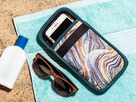 the marble phone case with a phone inside and velcro across the front to close it