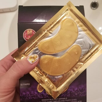 reviewer holding the gold eye pads