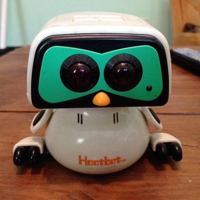 A Hootbot robot owl on a desk.