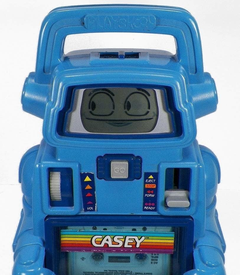 A close up of with a Casey the Talking Robot, which is blue with very simple animated face looking to the side.