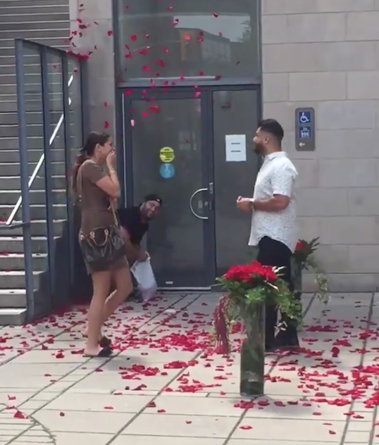 Guy Throws Rose Petals As Friends Get Engaged
