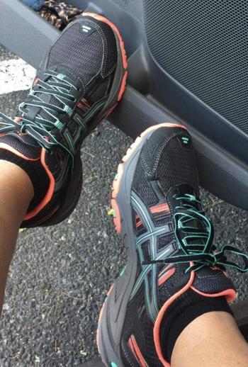 Reviewer wearing Asics Gel Venture sneakers
