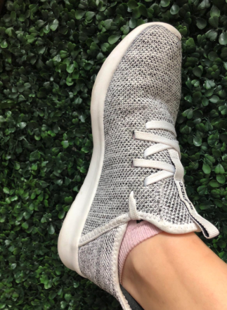 Reviewer showing side of Adidas Cloudfoam Pures