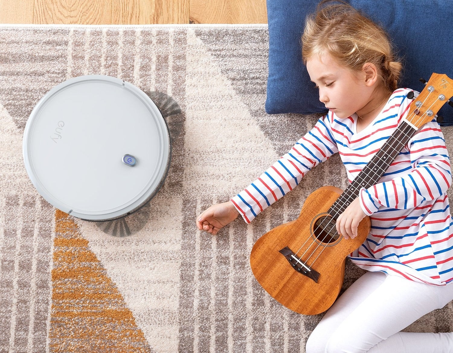 The robot vacuum next to a sleeping child